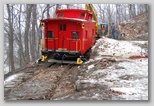 Dragging the caboose, on rails, up the slope.